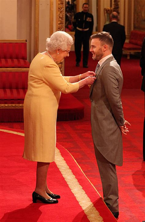 Gary Barlow Collects OBE From The Queen At Buckingham