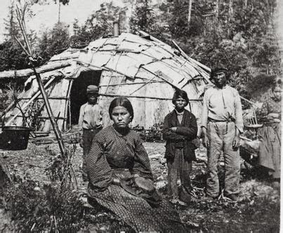 Ojibwe family in front of their home, MHS Photograph