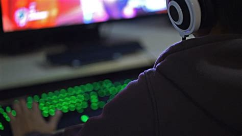 Over Shoulder shots of a Gamer Gaming with Headset video