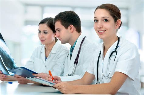 Multiracial Medical Students Studying In Classroom Stock