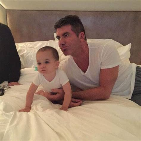 Simon Cowell & Son Eric Look Identical in Latest Twitter