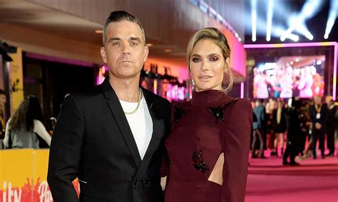 Robbie Williams HITS BACK after Louis Walsh slams wife